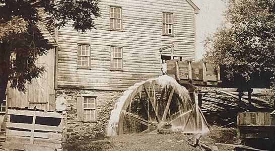schooley mill barn and water wheel in the 1800s in Waterford VA