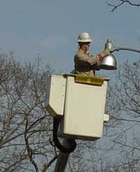 Installing Hubble light shields on Waterford's street lamps